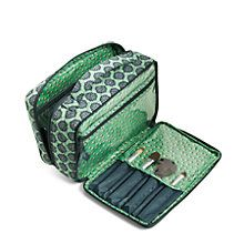 Offering plenty of room for all of your cosmetics and full-sized products, this large beauty bag also has a special spot for your most beloved brushes. The front compartment includes nine brush holders on one side and a long zip pocket on the other. The main compartment features four elastic mesh pockets.