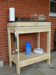 This is a potting bench with a fold-down cabinet. I think this would make a great multipurpose storage/tool stand for the shop!