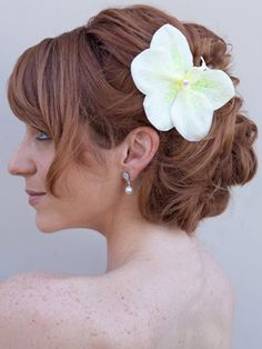 Not a huge fan of this up-do but I do like the placement of the orchid in her hair :)