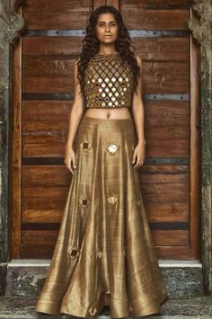 Stylish golden lehenga with a heavy mirror work