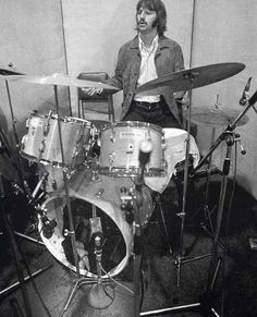 "Ringo in the studio with his butcher block Ludwig five-piece set. Probably for the Let It Be sessions. (Note the tea towel over the snare drum, for Ringo's signature ""thuddy"" sound.)"