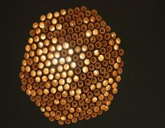 View from beneath a large wine cork chandelier LIKE THE LOOK FROM THE BOTTOM FOR SURE. LOOKS LIKE HONEYCOMB