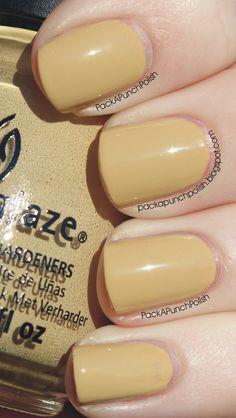 Kalahari Kiss by China Glaze is a yellow khaki color cream. It is part of the On Safari Collection. This is 2 coats, without a top coat. Full Blog Post: http://packapunchpolish.blogspot.com/2012/11/china-glaze-kalahari-kiss.html