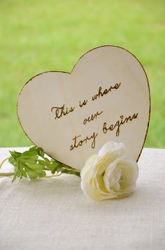 """Romantic rustic chic wood heart sign- Engraved wood heart """"This is where our story begins"""" via Etsy."""