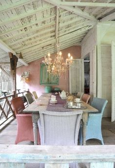 Shabby chic dining table with pastel chairs