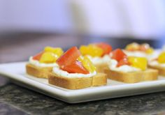 mint love social club: {easy appetizer: mini toasts with boursin, tomato & mango}