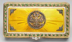 Fabergé rectangular box, hinged, gold, yellow sunburst guilloché and white enamel, rose diamond thumbpiece, plain interior. The lid of this box, in yellow guilloché enamel in a sunburst design, displays the Romanov double-headed eagle in gold, enamel and diamonds. Mark of Michael Perchin. It was purchased by the Maharaja of Bikanir from Wartski on 15 May 1937 at a cost of £95 and given to Queen Mary for her birthday, 26 May 1937.