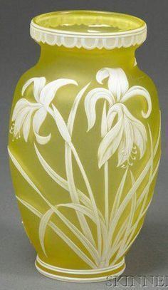 glass, England, A Webb Cameo glass, lily and butterflies vase, Art Nouveau, England, decorated rim on oval citrine body layered in white, cameo-cut with lily blossoms, spiked leaves and two butterflies in flight. Circa 1880-1920