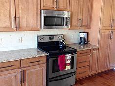 Howell Michigan kitchen renovation features CliqStudios Carlton Maple Carmel Jute Glaze cabinets