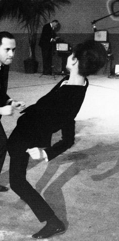 Audrey Hepburn photographed by Vincent Rossell dancing the twist at the studio de Boulogne during a break in the filming of Paris When it Sizzles, in September 1962.