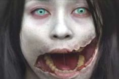 Carved_the_slit_mouthed_woman_3