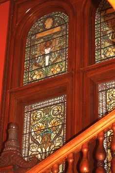 Tiffany glass and a mahogany newell post in the stairwell of Ponce de Leon Hall, Flagler College