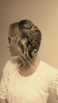 The latest and hottest trend in bridal hair dos, the side swept braid.  Numerous variations are  out there, and it makes for an interesting wedding if all the bridesmaids follow the brides lead.