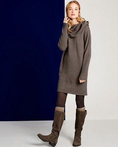 This sweater dress by EMU features casual details, including a mix of wide and narrow cables, thumbholes at the cuffs, and a cowl you can pull into an oversized hood. The relaxed top tapers to a shapely, short skirt — a silhouette that looks chic over tights or leggings.