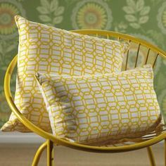 "Link-print throw pillow.  Product: PillowConstruction Material: Fabric Color: Yellow Features: Insert included Dimensions: 12"" x 20"" Note: Image depicts two pillows. Product is for lumbar pillow only."