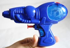"Cool! I remember having this squirt gun. I just love seeing things again that I knew so well as a child, especially the ones I'd forgotten about. *sigh* ...from ebay, ""VINTAGE SPACE WATER GUN No 0822"""
