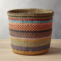 Medium scale basket handwoven from a muted rainbow of abaca twine. Each piece of twine is hand-dyed then carefully woven together. Rolled top edge and a slightly starched sides show off the craftsmanship. African Home Decor, Rope Basket, Basket Weaving, Laundry Hamper, Textiles, Storage Baskets, Decoration, Color Stripes, Twine