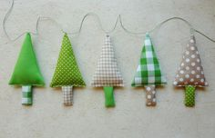 Fabric Christmas Garland Tree Garland Banner Bunning, Pennant in green, white and ecru. €22.00, via Etsy.