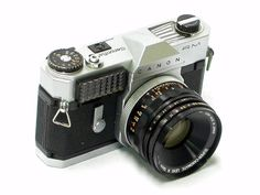 Canonflex RM 1961 - A late iteration of Canon's first series of single lens reflex (SLR).  This is has fewer professional features but includes builtin metering.  Canon had lost its battle with Nikon for the professional SLR market, so they capitalized on this rugged camera targeted at the high end consumer market.