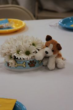 puppy baby shower centerpiece - but with purple violets and bulldog