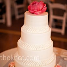 Pink Peony Cake: The white cake was simple yet elegant, decorated with buttercream pearls and topped off with a peony.