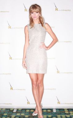 Taylor Swift sparkles in this Houghton sheath dress. #fashion