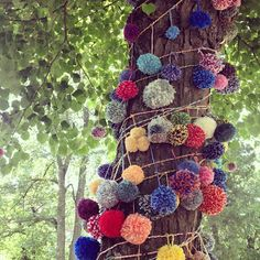 Idea: let's string poms together, and wrap 'em round a tree! Seriously?! WTF?!