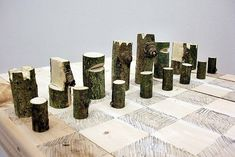 Log Chess Set, Peter Marigold, 2012. Single branch, plywood, graphite.