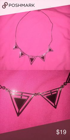 Black triangle statement necklace Statement necklace with black triangles on dark gray chain. Worn probably twice. Perfect condition. Price negotiable. Jewelry Necklaces