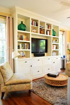 """See these built-ins? (They) hired a local handyman to build them to fit between those two windows and provide a ton of kid-friendly storage. So smart. I especially liked that they chose doors that are flush with the frame (it had a really clean look)."" - also like that they're not too deep, they just fit with the room!......House Crashing: Cozy Full Of Character 