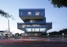 Glass boxes cantilever from the concrete core of Tatiana Bilbao's Bioinnova university building.