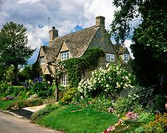 I want to live here.  And then take my sons and daughters down the lane to their little schoolhouse.  And I'll greet the grocer as I get my daily amount of groceries.  And it will be full of roses and ordinary-ness and magic.  That's my dream life.