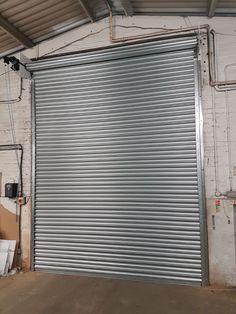 industrial roller shutters for high usage environments - warehouse and loading bays Shutter Designs, Rolling Shutter, Roll Up Doors, Roller Shutters, Modern Windows, Shutter Doors, Door Gate, Film Studio, Blinds