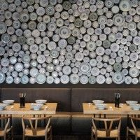 Hundreds of noodle bowls create a contemporary Asian wall decor.  I can see this interpreted using many different materials.