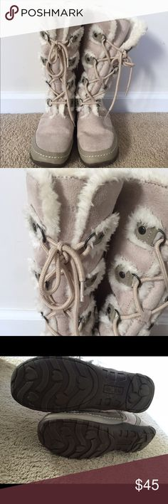 Beige winter boots Beige lace up fur boots. Fits a size 6. Good condition but has a little wear on the back as shown in the pic. Nine West Shoes Winter & Rain Boots