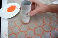 Painting fabric: pour your paint into a flat dish or saucer so that you can easily and evenly coat the bottom of your TP roll. Now just start dipping and stamping in rows!