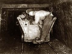 coal miners traveling underground every day to work..Tail End of Coal Car Trip Operator.