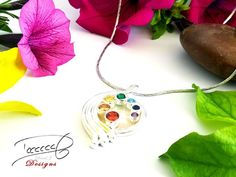 7 Chakras Pendant by David J.  Beautifully simple with crystals and a Pearl Shell base.  www.designermadejewellery.com  Stunning Pendant for that special someone!  #Chakras #sterlingsilver #conceptjewellery #davidjdesigns #davidj #pendantnecklace #pendant #giftideas #fashionaccessories David J, 7 Chakras, Fashion Accessories, Shell, Jewelry Design, Base, House Design, Concept, Pendant Necklace