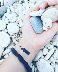 Black tattoo of the whale on the wrist