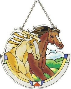 Joan Baker Designs SSB1008 2-Horses Art Glass Suncatcher, 3-Inch by 4-Inch by Joan Baker Designs. $14.00. Vivid translucent color for window display. Water-cut fired glass. Hand-painted. Chain included for convenient hanging in a window. A horse lover's favorite. Two horses run wild and free on this hand-painted, water-cut Suncatcher. For more than 40 years, Joan Baker Designs' talented artisans have created stunning decorative art glass items. Each piece is designed in our San...