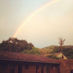 Camino de Santiago Primativo Spain. Rainbow over monastery.