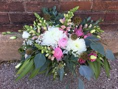 Loved it! Pinned it! A Blooming Envy Design! Wedding Bouquet designed with Pink Snapdragons, Pink Ranunculus, Pink Lisianthus, White Mums, Baby's Breath and Eucalyptus.