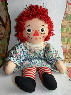 Raggedy Ann...mine had the same dress. I still have the dress on a stuffed animal.