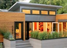 Love the combo of wood/metal exterior on this one.  And the planters...   # Pin++ for Pinterest #