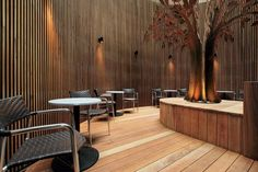 Metal wall sculptures create a focal point in this local Melbourne pub. Incorporate metal artwork and metal wall art decor into your outdoor living space with metal 'courtyard tree' by Entanglements