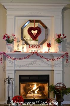 Amy: I know how much you love mantel decorating so I pinned this for you!!! From Adventures in Decorating: Our Valentine Mantel.