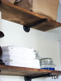 Use plumbing fixtures as industrial-style brackets to hang DIY shelving.