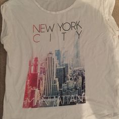 Loose fitting New York City white tee shirt Loose tee shirt with cuffed sleeves. Graphic of New York City. Great condition slightly worn. Cotton On Tops Tees - Short Sleeve