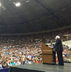 Democratic presidential candidate Bernie Sanders is gaining on Hillary Clinton, and fast. The U.S. Senator's rapid rise was no more keenly felt than when he packed the Veterans Memorial Coliseum in Madison, Wisconsin, last night, filling its 10,000 seats - a feat for any candidate, and especially a long-shot like Sanders. 'Tonight we have made a little bit of history,' the white-haired Sanders said at a podium positioned between Wisconsin and United States flags at the outset of his speech befor