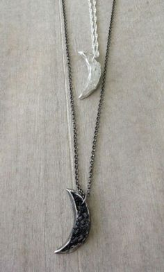 http://dreamsofnorway.com/products/crescent-moon-necklaces
